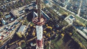 Telecommunication tower with cellular antennas in a residential area of the city stock video footage