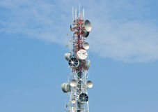 Telecommunication tower on clear blue sky Stock Photo