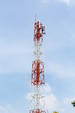 Telecommunication tower with cloudy sky. Royalty Free Stock Photos