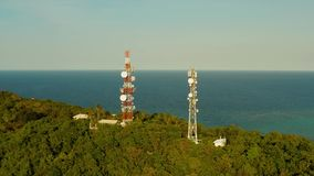 Telecommunication tower, communication antenna in asia stock footage