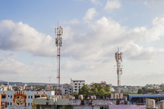 Telecommunication tower in community. Two Telecommunication tower in community Stock Photo