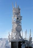 Telecommunication tower frozen under blue sky Stock Photography