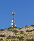 Telecommunication tower on a hill Stock Images