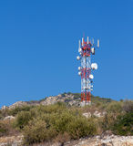 Telecommunication tower on a hill Stock Image