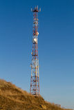 Telecommunication tower on a hill Stock Photography