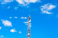 Telecommunication tower mast TV antennas wireless technology. With blue sky Stock Photography