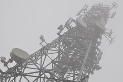 Telecommunication tower in the mist Stock Photo