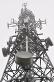 Telecommunication tower in the mist Royalty Free Stock Images