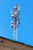 Telecommunication tower for mobile phone with antennas Stock Image