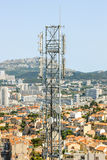 Telecommunication tower with multiple antennas and data transmit Stock Photos
