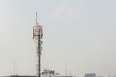 Telecommunication tower with multiple antennas and data transmit Stock Photo