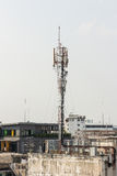 Telecommunication tower with multiple antennas and data transmit Royalty Free Stock Photo