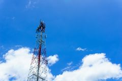 Telecommunication tower for radio wave or mobile cellular with beautiful clear blue sky and little clouds. telecommunication. Telecommunication tower for radio Royalty Free Stock Photo