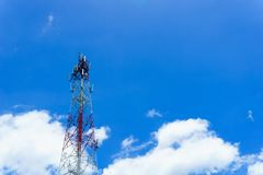 Telecommunication tower for radio wave or mobile cellular with beautiful clear blue sky and little clouds. Telecommunication and network connected concept Stock Photos