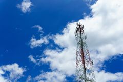 Telecommunication tower for radio wave or mobile cellular with beautiful clear blue sky and little clouds. Telecommunication and network connected concept Royalty Free Stock Photos
