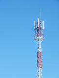 Telecommunication tower red and white with blue sky Stock Photo