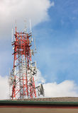 Telecommunication  tower,roof and sky cloudy background. The telecommunication  tower,roof and sky cloudy background Royalty Free Stock Photography