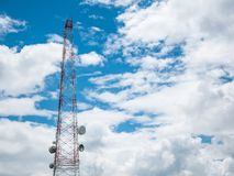 Telecommunication tower and satellite on blue sky Stock Photo