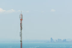 Telecommunication tower on sea and sky background Royalty Free Stock Photo