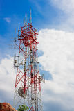 Telecommunication  tower and sky cloudy background. Stock Photography