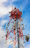 Telecommunication  tower and sky cloudy background. Stock Images