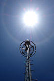 Telecommunication tower with Solar Flare Stock Images
