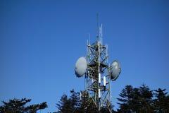 Telecommunication tower. Under blue sky Stock Photos