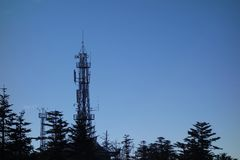 Telecommunication tower. Under blue sky Royalty Free Stock Photography