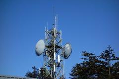 Telecommunication tower. Under blue sky Stock Image