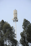 Telecommunication tower with tree Stock Photography