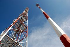 Telecommunication Towers. Image of communications towers against blue sky Royalty Free Stock Photo