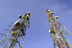 Telecommunication towers with blue sky Royalty Free Stock Photos