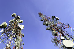 Telecommunication towers with blue sky Royalty Free Stock Image