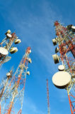 Telecommunication towers with blue sky Stock Photos