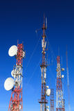 Telecommunication towers with many satellite dishes Stock Image