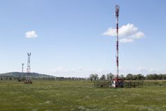 Cellular station towers in sunny summer day Royalty Free Stock Photography