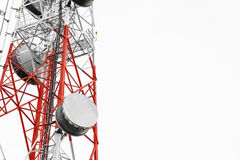 Telecommunication towers with TV antennas and satellite dish, isolated on white background Royalty Free Stock Images