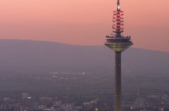 Telecommunications. Tower, in Frankfurt Germany with the Taunus in the background royalty free stock photos