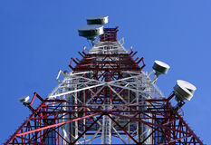 Telecommunications. Tower with the blue sky background Stock Photo
