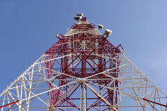 Telecommunications. Red and white telecommunication tower Royalty Free Stock Photos