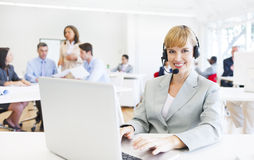 Telecommunications Agent on a Busy Office Stock Image