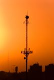 Telecommunications Antenna. Against a red sky Royalty Free Stock Photos