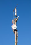 Telecommunications antenna. On blue sky royalty free stock image