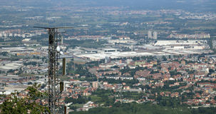 Telecommunications antenna over the immense metropolis Stock Images