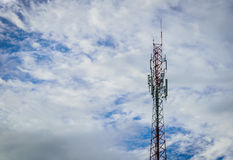 Telecommunications antenna tower for mobile phone. With the blue sky background Royalty Free Stock Photos