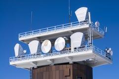 Telecommunications antennas. Telecommunications antenna relay against blue sly Stock Photos