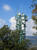 Telecommunications and broadcasting tower with parabolic dish an Stock Image