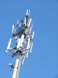 Telecommunications cell phone tower with antennas Stock Image