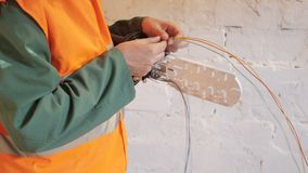 Ethernet cable and server. The Telecommunications Engineer works with a cable to transfer Internet data stock video