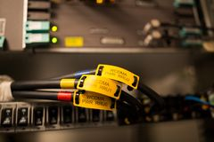 Telecommunications hardware plugged. Telecommunications hardware of famous telco brands is on. Switches and cords are plugged. Base radio station for wireless Royalty Free Stock Photos